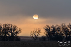 December 3, 2016 - Low clouds at sunrise make the sun almost look like the moon. (Tony's Takes)