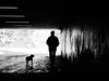 walking the dog (Sandy...J) Tags: olympus tunnel underpass walking atmosphere noir darkness light dog man grafitti blackwhite monochrom streetphotography urban