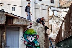 Fixing the roof (Melchita) Tags: streetphotography street streetcolor streetphotographycolor streetscenes colorphotography urbanphotography urbanlife urbanscenes italy palermo melchita