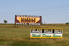 Billboards (saish746) Tags: road park camping wild camp people blackandwhite sculpture dog white mountain black monochrome sign yellow wall night river fossil star volcano drive george washington store buffalo memorial long exposure outdoor thomas south great pass trails surreal goat motel abraham tent roosevelt hills rushmore advertisement formation mount soil national cedar lincoln drug jefferson keystone badlands prairie brule plains bison eruptions prehistoric volcanic groupshot signboard dakota mounds theodore ecosystem the borglum paleosols gutzon mixedgrass