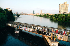 BU Bridge + Skyline (Alexander Tran | atranphoto.com) Tags: city bridge boston skyline train river ma graffiti university track cityscape massachusetts charles hancock mass bu prudential bubridge atran atranphoto