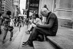 Sleep Less Read More (Guilherme Nicholas) Tags: street new york city nyc people bw white ny black streets art monochrome nikon cityscape outdoor manhattan read nicholas crowded guilherme