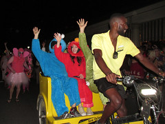 NOLA Halloween: Sesame Street Costumes (shaire productions) Tags: nola neworleans image picture photo photograph city urban night evening event halloween party outdoor imagery costume revelry street people fun happy celebration float parade