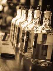 Moonshine (ildikoannable) Tags: bottles bar moonshine olympus macro closeup dixons tasteandtour