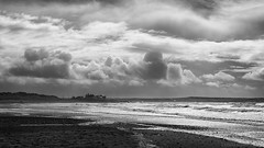 a stormy day and sea on Anglesey (lunaryuna) Tags: uk wales anglesey island coast beach rhosneigrbeach sea seascape landscape coastline walkers storm sky clouds cloudscape stormclouds weathermood blackwhite bw monochrome lunaryuna