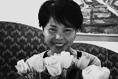 Sunshine Smile (catarinae) Tags: sunshine smile woman pinay philippine germany deutschland bw black white roses aunt family restaurant bouquet flowers warmth short hair