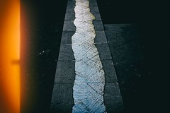 La voie bleue (Calinore) Tags: paris city ville france iveme 6eme blue water eau road route egout pavement trottoir yellow