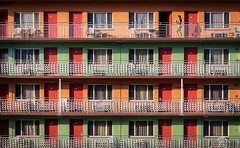 Motel (Darren LoPrinzi) Tags: 5d canon5d fl canon florida miii motel hotel doors rooms windows pattern architectural pastel pastels pastelcolors orange green peach red railing repeatingpatterns repeatingpattern curtains grid rows columns