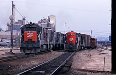 Standing in the Shadows (GRNDMND) Tags: trains railroads southernpacific espee sp locomotive ge u28c emd gp9e coltontower colton california