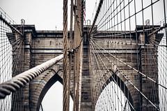 Unerring Support (ProPeak Photography) Tags: architecture blue bridge brooklynbridge flag newyork newyorkcity red winter
