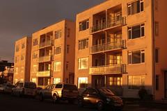 Apartment Living (Henry Hemming) Tags: sea flat apartment golden sun evening sunset cars street road shine glare flare light dazzling