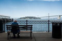 The Lonely Man (apinedaphotography) Tags: sf california street old bridge summer sun man water cali fun photography bay photo san francisco exposure fuji skin alien fran adobe fujifilm lightroom x100s