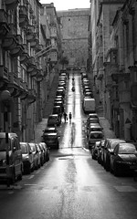 The Sunny Side Of The Street (DobingDesign) Tags: streetphotography blackandwhite malta valletta people pedestrian quiet hill cars road contrast centre architecture slope gradient stroll outdoor uphill