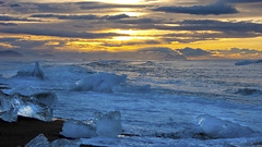 a natural Song of Ice and Fire (lunaryuna) Tags: iceland southeasticeland jokulsarlon glacierbay glacialicefloes sunset sundown dusk sky clouds cloudscape landscape seascape coast coastallandscape wake waves light lastlight lightmood lunaryuna ngc