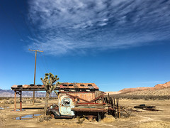 Where the wind blew sand and hid the road (Maureen Bond) Tags: truck ca desert tires roof station wires pole windturbines puddles joshuatree wood maureenbond iphone mining privateproperty clouds bluesky mojave