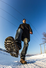 Step on it! (ToMpI97) Tags: step it big man guy dude huge fisheye giant shoe boot rubber distortion samyang 8mm curve world sky snow winter village rural field pole wire electricity sunglasses ken block spy hungary eger magyar