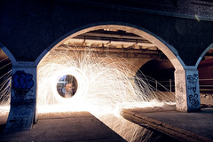 Under the bridge (Pat Charles) Tags: steelwool burn burning spin spinning flame sparks reflection reflected reflections tripod longexposure bridge floodway under nikon melbourne victoria australia pylon pipes twirl twirling night nighttime evening
