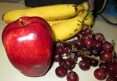Fruit Still Life. (dccradio) Tags: lumberton nc northcarolina robesoncounty fruit apple reddelicious grapes bunch bunchofgrapes bananas bunchofbananas eat food snack red purple green yellow kitchencounter