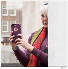Secretly take a picture. (Digifred.) Tags: digifred 2017 amsterdam nederland netherlands holland straat street city grachten streetphotography iphone girl purple selfie fotograaf photographer streetportrait pentaxk3 people portret portrait candid