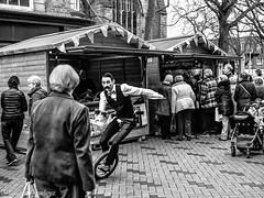 Unsteady waiter at the Wakefield Rhubarb Festival. (steve.gombocz) Tags: urbanstreet blacknwhite greyscale monochrome streetscene blackwhite bwphotos bwstreet bw bwstreetscenes flickrstreet flickrbw bwflickr blackwhitephotos blackwhitephotographs blackwhitephotography blackwhitestreet bwstreetphotography streetlife street streetphotographs wakefield wakefieldrhubardfestival bwphotography streetbw noiretblanc schwarzundweiss negroyblanco zwartwit neroebianco sortoghvid mustavalkoinen svarthvitt svartoghvitt svartochvitt czarnyibiaty pretoebranco noirblanc schwarzweiss negroblanco pretobranco nerobianco market festival rhubarb marche markt music entertainment streetentertainment markedet ryneh olympus olympususers olympuscamerausers olympusbw olympusmzuiko25mmf18lens olympusem5mark2 olympusdigitalcamerausers olympusblackwhite micro43rdsuk olympuszuikodigitalclub olympuseurope waiter monocycle olympusstreet bwpictures wakefieldbw wakefieldmonochrome wakefieldfestival flickraddict streetpictures explorebw explore flickr
