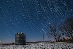 Silo trails! (Wubtec) Tags: nikon d3300 astrophotography rokinon 14mm star trails milkyway missouri space saintlouis cold winter silo farm warm blue white field wheat corn silver polaris circle