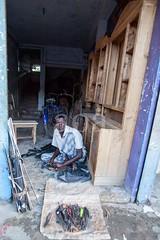 5D8_7470 (bandashing) Tags: umbrella fixer shoes crude repair mend balagonj market vendor shops street sylhet manchester england bangladesh bandashing aoa socialdocumentary akhtarowaisahmed