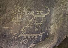 Petroglyphs / Chaco Culture NHP (Ron Wolf) Tags: anasazi anthropology archaeology chacoculturenationalhistoricalpark chacoan nationalpark nativeamerican puebloan anthromorph anthropomorph bighornsheep bird cliff footprint panel petroglyph rockart shield zoomorph newmexico
