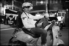 (teknopunk.com) Tags: asian c e asia helmet o electrobike h outdoor m s china blackwhite photography location scooter chinese leicammonochromtyp246sn4963868 ebike 35f2uchexanonsn625 people oneman mobilephone blackandwhite monochrome gear 35mmlens shanghai