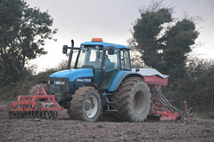 New Holland TM135 Tractor with an Accord Sacompactor Seed Drill, Kuhn HR3003 Power Harrow & Farm Force Front Press (Shane Casey CK25) Tags: new holland tm135 tractor accord sacompactor seed drill kuhn hr3003 power harrow farm force front press winter barley sow sowing set setting drilling tillage till tilling plant planting crop crops cereal cereals county cork ireland irish farmer farming agri agriculture contractor field ground soil dirt earth dust work working horse horsepower hp pull pulling machine machinery grow growing nikon d7100 onepass one pass