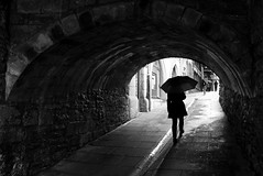 (cherco) Tags: umbrella paraguas woman bridge puente rain lluvia girl mujer under debajo alone solitario solitary silhouette shadow silueta sombra lonely blackandwhite blancoynegro composition composicion urban city ciudad canon street calle stone piedra