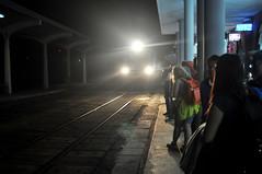 Night train (Roving I) Tags: trains travellers railwaystations railwaylines railwaytracks lights headlights columns steel arriving travel publictransport passengers night hue vietnam backpacks backpackers