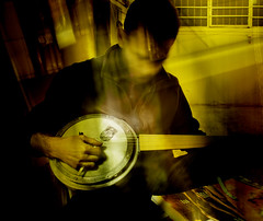 The Player. (df-stop.) Tags: art montage turkishbanjo instrument greece thessaloniki sabbasmavrithis city urban underground man music musicalinstrument playing playingmusic macedonia basement lute cookingpot strings stringedinstrument yellow night evening light abstract blur hand arm head noface traditional canon dfstop dwainfarmery digitalphotography window surreal metal istanbul macedoniagreece makedonia timeless macedonian μακεδονια