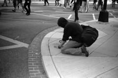 Guy Fawkes Protestor Vandalizes Sidewalk (John Bense) Tags: guy fawkes guyfawkes film analog blackandwhite monochrome city street urban spray paint spraypaint vandal vandalism sidewalk protest washingtondc