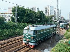 Two locomotives. (SouthernSky24601) Tags: guangzhou zeiss raw zoom sony adobe fullframe alpha za ultrawide a7 canton lightroom  oss carlzeiss   cmos arw   mirrorless  vsco variotessart   emount  opticalsteadyshot  e ilce7  fe1635 sel1635z