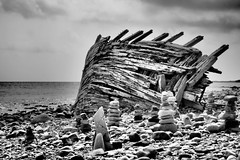 Traces of a storm II (Jens Haggren) Tags: sea sky water clouds sweden stones olympus shore wreck omd öland em1 swiks