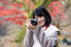 Young woman smiley taking pictures on dead railroad track (Apricot Cafe) Tags: 20s asianethnicity canonef85mmf18usm japan japaneseethnicity kyoto minikyoto2016 autumn autumnleaves beautyinnature camera change charming cheerful enjoying foliage freshness happiness hope japanesefallfoliage japanesemaple leaves mapleleaf nature oneperson onlywomen outdoors people railroadtrack refreshing selectivefocus smiling takingpictures toothysmile tranquility traveldestinations walking wishing woman youngadult