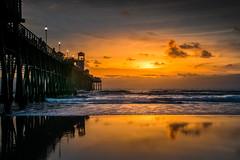 Different Cloth (henryhintermeister) Tags: sunsets beaches piers ocean sand lights sundown oceanside cali california cloudsstormssunsetssunrises