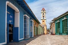 Cobblestone Street and Bell Tower (danielacon15) Tags: cuba 2016 trinidad streetphotography travel outdoors bell tower colorful