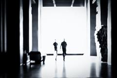 walk (zzra) Tags: blur focus black white contrast lobby man men walking