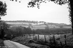 Distant bonfire (judy dean) Tags: judydean 2017 sonya6000 cotswolds hills farmland bonfire smoke countryside countrylane fields fence