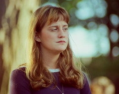 What is She Looking At? Something Displeasing at the Charlotte Arts and Crafts Fair - July 1980 - Shot on Film (Robb Wilson) Tags: freephotos charlottemichigan charlotteartsandcraftsfair summerof1980 youngwomen 200mmlens