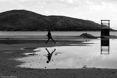 ~flyin' girl~ (Τάσος Τσουκαλάς 3.000.000views!!!!) Tags: tasostsoukalasphotography blackwhite blackdiamond blackandwhite girl fly sea mountains outdoor monochrome