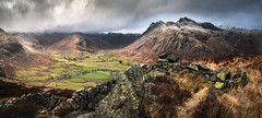 Langdale View (Dave Fieldhouse Photography) Tags: langdale langdalevalley langdalepikes lakedistrict cumbria cumbrianmountains nationalpark stitchedpanorama panorama drystonewall weather clouds hailstorm winter grasses farmland fuji fujixt2 fujifilm landscape outdoors sky drama dramaticlight sidepike fells
