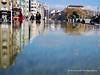 The reflected city: Taksim (`ARroWCoLT) Tags: istanbul samsung nxmini 17mm f18 türkiye turkei turkey taksim harbiye bluesky blue sky cityscape manzara bina simitci people aqua park reflection city yansıma outdoor landscape pond havuz