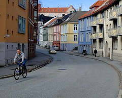 Getting around (halifaxlight) Tags: street urban car norway buildings spring downtown apartments cyclist pedestrians colourful bergen