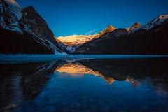 Sunrise over the frozen lake (Pradipta Basu) Tags: sky mountain lake snow canada nature sunrise canon landscape rockies eos frozen peak banff lakelouise ef1740f4l albarta 5dmarkiii lee09ndgrad pradiptabasu