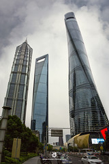 The Three Giants of Shanghai (fesign) Tags: architecture blue buildingexterior business businessfinanceandindustry car chinaeastasia citylife cityscape cloudsky colourimage day development directlybelow downtown finance financeandeconomy futuristic growth horizontal jinmaotower large lujiazui metropolitan nopeople outdoors overcast photography scale shanghai shanghaitower shanghaiworldfinancialcenter skyscraper threeobjects traffic travel