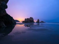 The fisherman (bertigarcas) Tags: blue sea orange beach azul night marina landscape fisherman sand rocks asturias playa paisaje olympus arena nocturna naranja zuiko rocas pescador omd 918 bayas em5