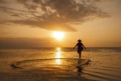 The Net Fisherman (Gede Suyoga) Tags: morning travel sunset sea sky people bali sun reflection net beach nature water silhouette sunrise canon indonesia landscape eos fisherman asia human hi lowtide sanur waterscape balibeach pantaikarang