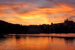 The sunset over the Vltava (Yuri Rapoport) Tags: prague praguecastle pražskýhrad malástrana hradčany czechrepublic thevltavariver night church stvituscathedral stnicholaschurchmalástrana